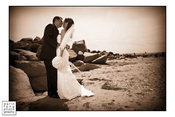 bride and groom on the beach at teh Hotel Del Coronado